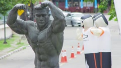 Statue of strongman near Rajamangala stadium, Bangkok - 2 Stock Footage