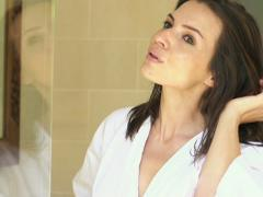 Young woman tousling her hair in the bathroom super slow motion 240fps NTSC Stock Footage