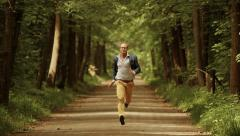 Man running fast forward. career progress. young male person. green park Stock Footage