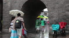 Tourists walking in Pingyao ancient county on a rainy day Stock Footage