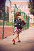 beautiful young woman walking on the sports ground - stock photo