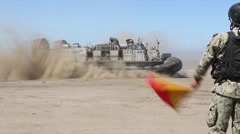 Hovercraft unloading tanks 4th Tank Battalion Annual Training - stock footage