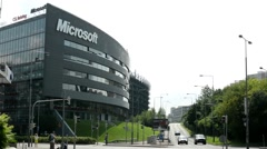 Microsoft headquarters - street with cars and people - nature (trees and grass)  Stock Footage