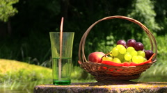 Grape peach fruits and glass with champagne cider on millstone Stock Footage
