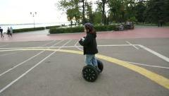 Boy riding on a Segway Stock Footage