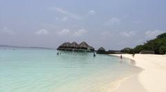 Swimmers Enjoy Beautiful Island Paradise Stock Footage