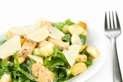 Caesar salad isolated on white Stock Photos