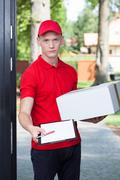 delivery man requesting a signature - stock photo