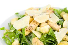 caesar salad isolated on white - stock photo