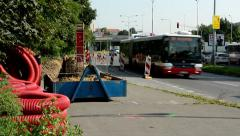 Reconstruction the bus stop with workers - road with passing cars Stock Footage
