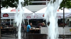 Restaurant - outside seating - couple (men and women). Fountain in foreground Stock Footage