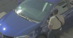 Meter maid, parking enforcer Stock Footage