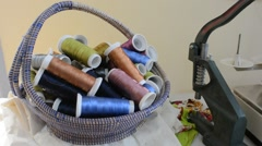 Sewing machine, colored sewing thread in a basket Stock Footage