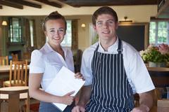 Portrait of chef and waitress in restaurant Kuvituskuvat