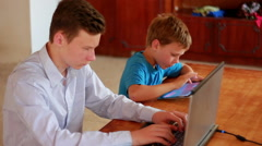 Two Brothers Using Laptop And Ipod Stock Footage