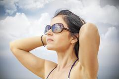 Woman keep the hair on the cloudy sky background Stock Photos