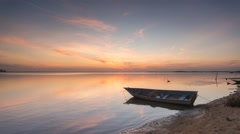 Timelapse Of Single Boat at Calm Lake During Sunrise Stock Footage