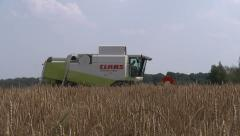 combine harvesting field of wheat - stock footage