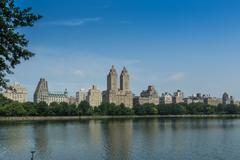 central park, resevoir and skyline. - stock photo