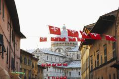 Flags flying over city street, pisa, toscano, italy, Stock Photos