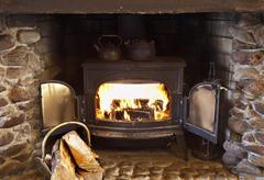 Fire burning in wood stove Stock Photos
