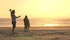 Dad and Son Play Catch at Beach Stock Footage