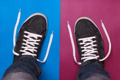Stylish blue gym shoes with white laces Stock Photos