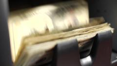 Close of up money being counted from a machine Stock Footage