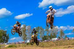 motocross riders on the race - stock photo