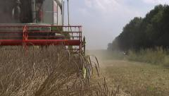 combine harvesting crop front view - stock footage