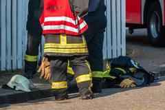 Firemen after extinguishing a fire Kuvituskuvat