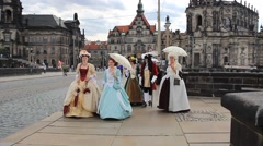 People in baroque outfit strolling in the city of Dresden, Germany Stock Footage