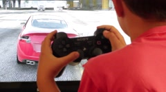 Young Child Playing Playstation in front of TV Stock Footage
