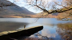 Reflections over beautiful water with stone pier - English Countryside Stock Footage