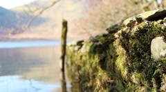 Pull Focus Along Moss Covered Stone Pier Reflections beautiful water Stock Footage