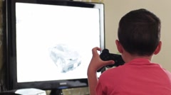 Young Child Playing PS3 at Home Stock Footage