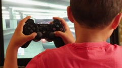 Young Child Playing Playstation Stock Footage