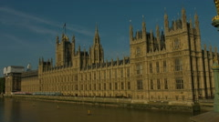 Houses of Parliament pan to river Thames 01. 4K - stock footage