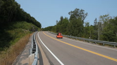 Orange Trike passes on Rural highway in Ontario, Canada. Stock Footage