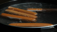 Boiling hot dogs. Stock Footage