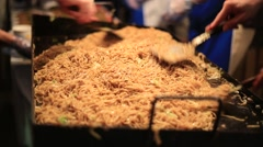 Yakisoba fried noodles shop at a traditional summer festival in Tokyo Stock Footage
