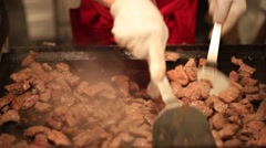 Grilled meat shop at traditional summer festival in Tokyo Stock Footage