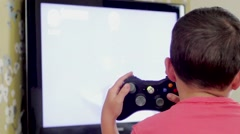 Young kid Playing Microsoft Xbox 360 - stock footage