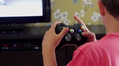Young Child Playing Xbox 360 in front of a LCD Stock Footage