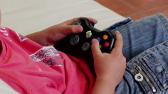 Young Child Playing Xbox 360 Console - stock footage