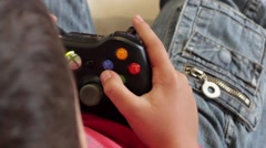 Young kid Playing Xbox 360 - stock footage
