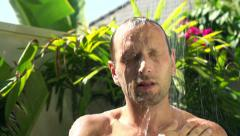 Man washing his body under shower HD Stock Footage