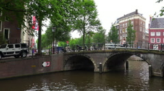 Romantic view on a small bridge in Amsterdam at Gentlemens canal - stock footage
