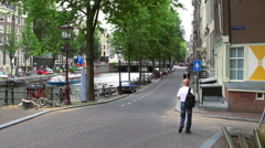 Gentlemen canal in Amsterdam crossing Leidsegracht - stock footage