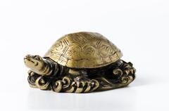 Feng shui golden metal turtle on white Stock Photos